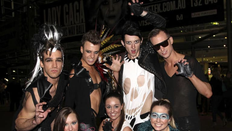 Fans dressed as Gaga's monsters pose for photos as they arrive for the Lady Gaga's concert in Sydney.
