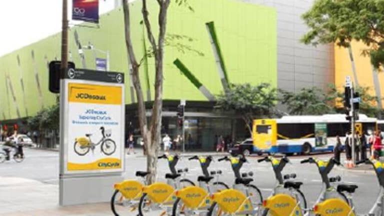 A CityCycle station. The bicycles and vertical advertising space carry ads.