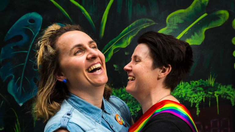 """Zoe McDonald and Katie Larsen celebrate the """"yes"""" vote at the State Library in Melbourne."""