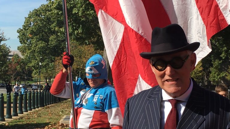 """Roger Stone at a pro-Trump protest in Washington, DC, with """"Captain America""""."""