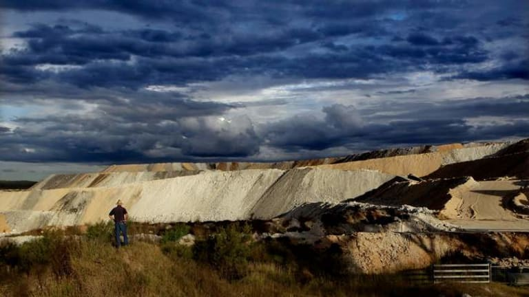 Storm clouds gather: Phil Laird in Leard State Forest, at Maules Creek in north-western NSW.