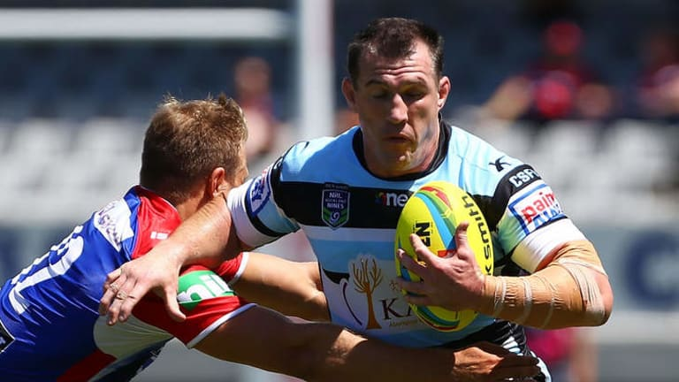 Cronulla captain Paul Gallen makes a break during the match against the Newcastle Knights in the Auckland Nines at Eden Park on the weekend.