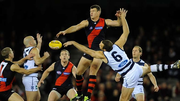Hands up: Essendon ruckman David Hille battles with Geelong counterpart Brad Ottens last night.