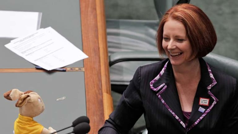 Moving up in the ratings ... Prime Minister Julia Gillard with Wally the Australian Rugby Union Wallabies mascot during question time on Thursday.