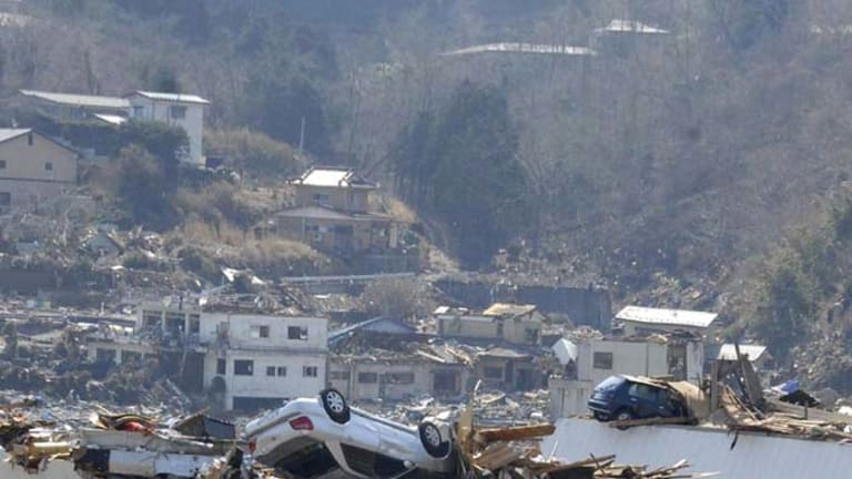 Vehicles sit on three-storey building after the tsunami that hit the town of Onagawa in Miyagi prefecture.