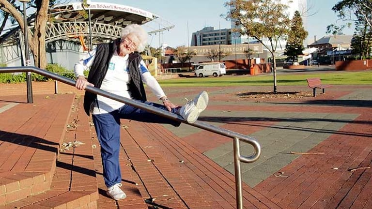 89-year-old Lee Nilon stretches her hamstring in Bunbury this morning before heading off.