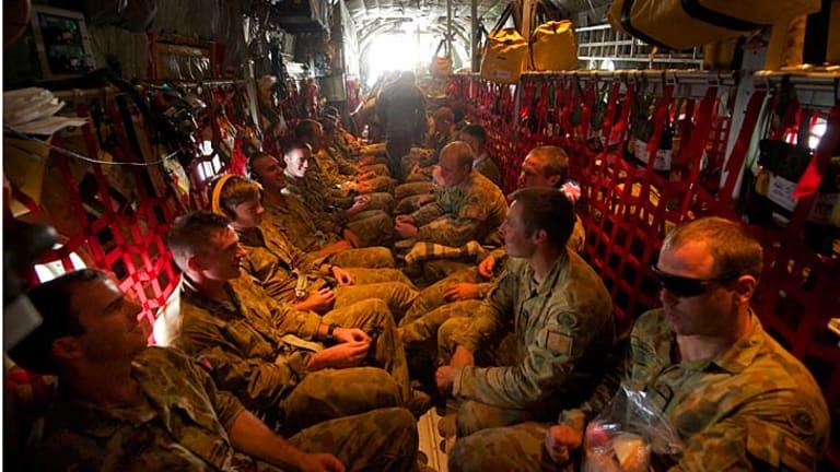 The last 50 Australian infantry personnel leave Dili.