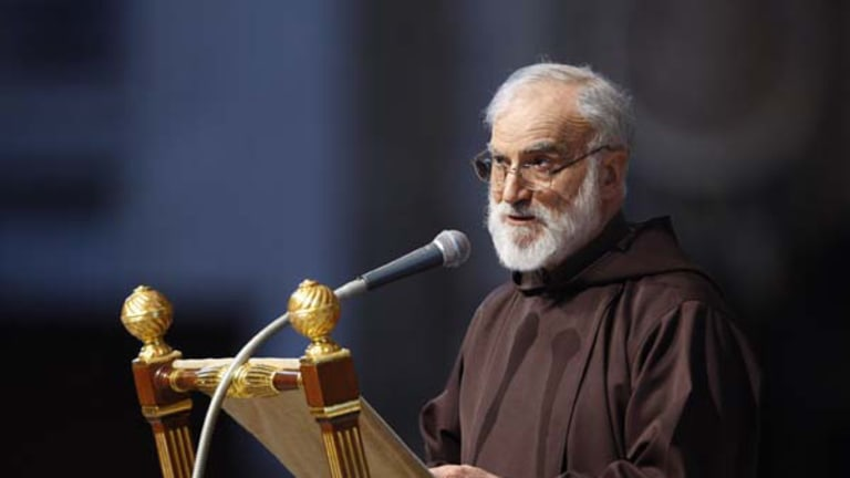 Reverend Raniero Cantalamessa delivers the Good Friday homily during a service celebrated by Pope Benedict XVI  in St. Peter's Basilica at the Vatican.