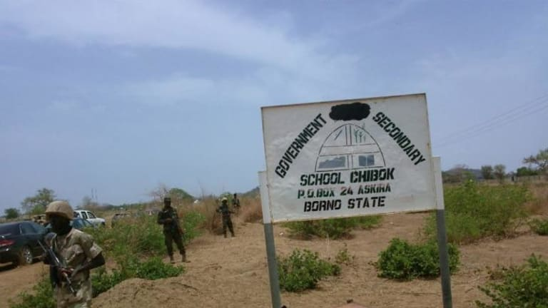 Soldiers stand guard in front of  Government Girls Secondary School in Chibok.