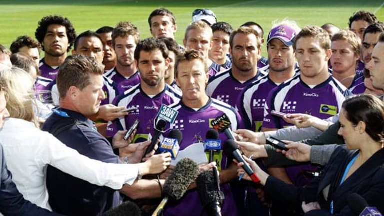 'We ain't going to surrender' ... Storm coach Craig Bellamy, backed by all his players, faces the media yesterday but all is not well behind the scenes.