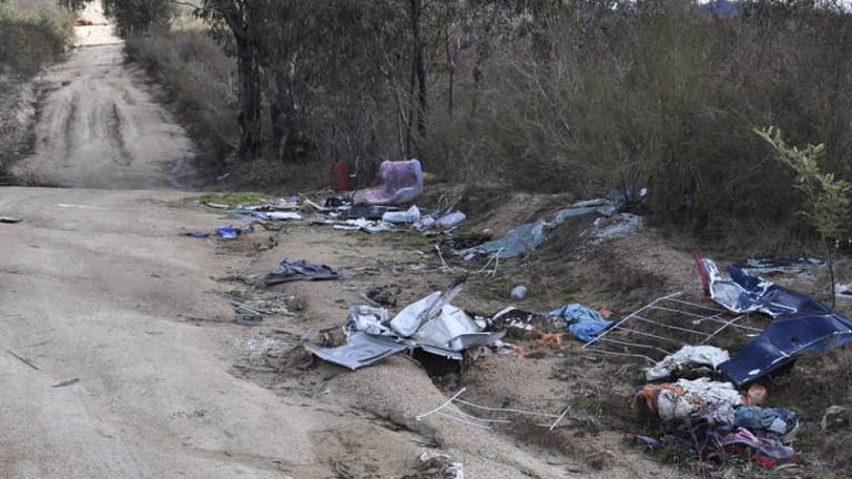 An assortment of rubbish - including a kitchen sink - dumped near Gibraltar Peak on the edge of Tidbinbilla Nature Reserve.