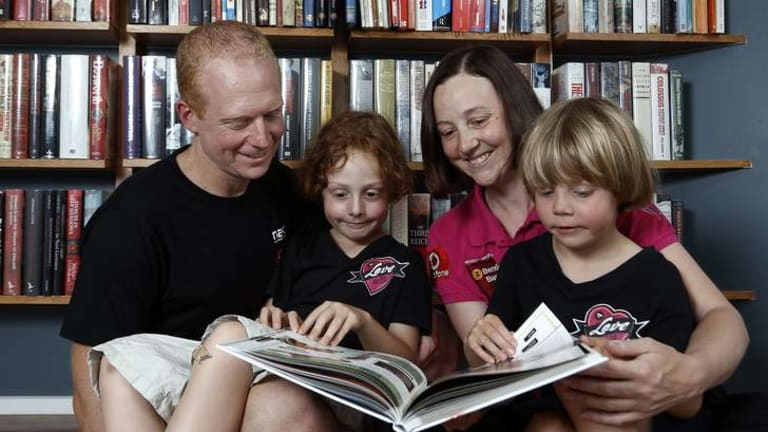 Mike,  Willoughby, Connie and Hamilton reading at home in Kingston.