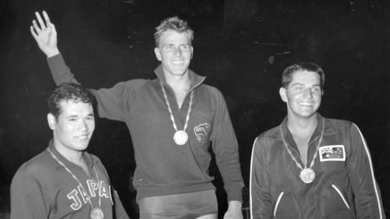 Champion ... Murray Rose after retaining the 400 metres freestyle title in Rome flanked by Tsuyoshi Yamanaka of Japan and John Konrads of Australia.