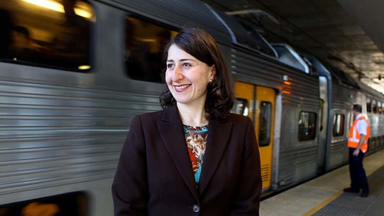 Broken promises ... Transport Minister Gladys Berejiklian at Chatswood train station, where thousands of disembarking commuters will be unable to get on city-bound trains already operating at capacity.
