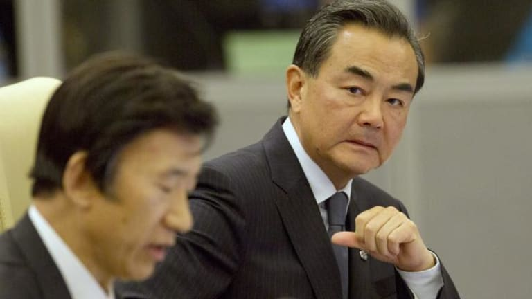 China's Foreign Minister Wang Yi (right) and South Korean counterpart Yun Byung-se at the ASEAN summit on Saturday.