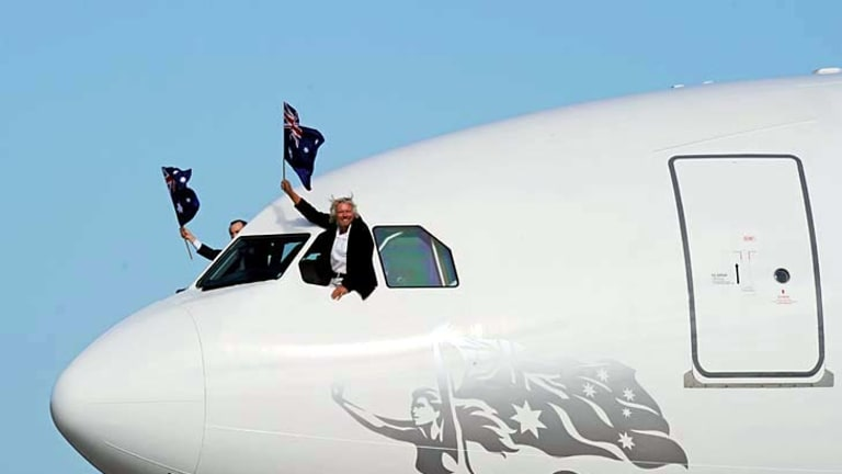 Richard Branson (R) and Virgin Australia CEO, John Borghetti (L) arrive on the new airline's Airbus A330-200 at Sydney Airport.