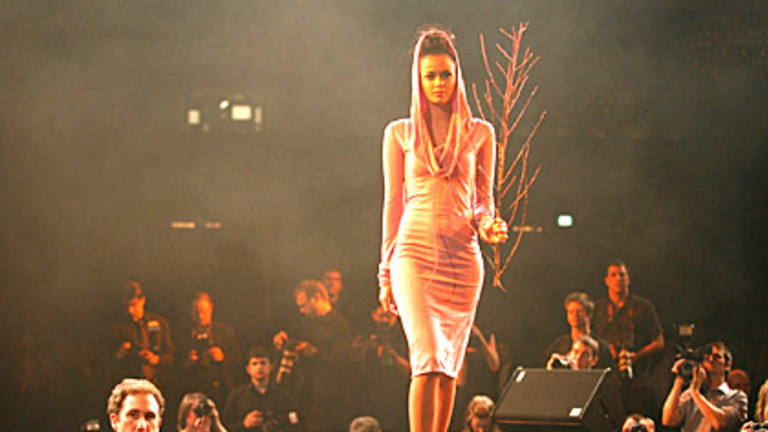 A model on the catwalk at this year's Fashion+Aid gala.