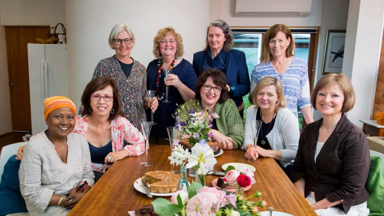The Singed Sisters were a group of women who supported each other in the aftermath of the January 2003 bushfires. Nearly 15 years after the disaster, the sisters have released a cookbook which tracks their journey from devastation to celebration. Pictured are (standing l-r): Liz Walter, Jane Fitzgerald, Peta Mackenzie Davey and  Julie Pham and  (seated l-r) Chandani Prammer, Liz Tilley, Alison Mills, Karen Downinga dn Sue Kukolic