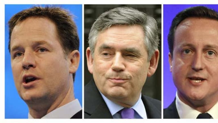 Going to the polls ... Prime Minister Gordon Brown (C) is flanked by Liberal Democrat leader Nick Clegg (L) and Conservative leader David Cameron.