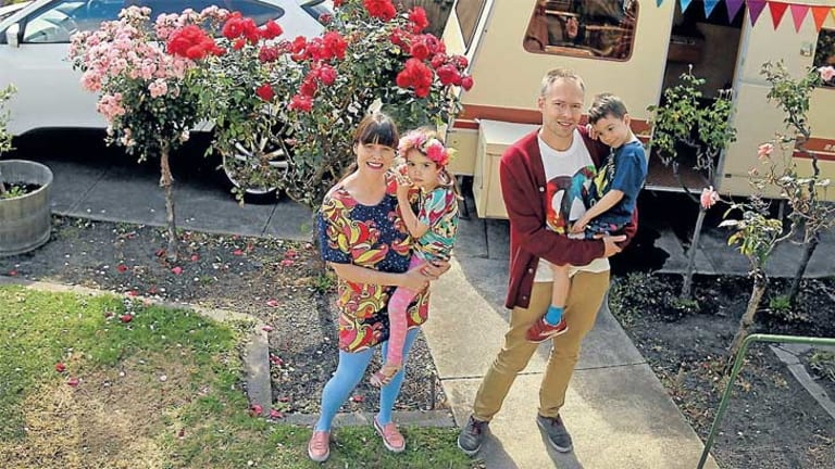 Road ready: Samone and Tim Bos at their Elsternwick home with their twins, Saffron and Jasper. They are about to take the caravan to Mildura on a camping weekend holiday.