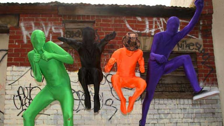Morphsuit fans embrace their inner superhero. The suits are porous enough to see, breathe and drink through. <i>Picture: Ken Irwin</i>