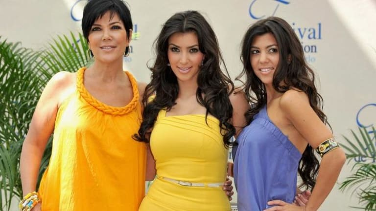A different kind of show: Kris Jenner with daughters Kim and Kourtney Kardashian.