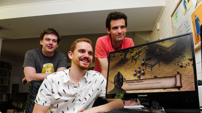 "Peter Castle, centre, with fellow creators from left, Peter Simpson and Tom Cox, have developed their game ""Tahira"" while working in other jobs."