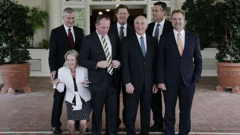 Nationals MPs pose for photos afer the swearing in ceremony at Government House in Canberra on Wednesday.