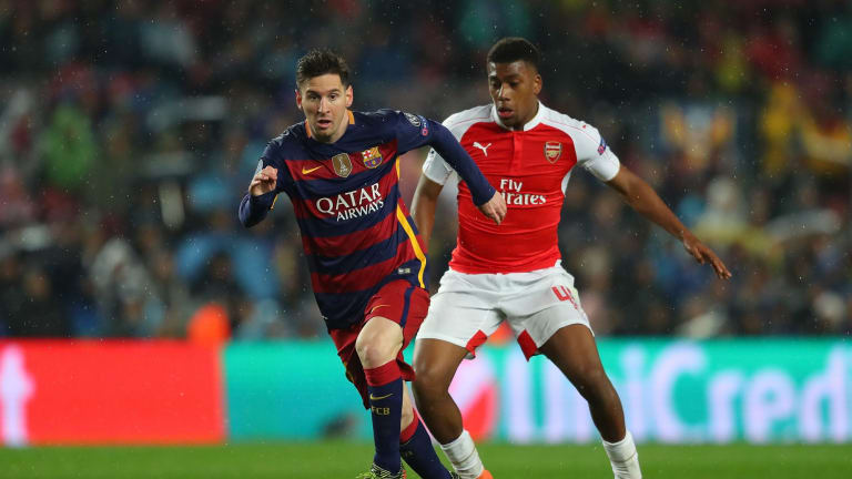 Lionel Messi of Barcelona and Alex Iwobi of Arsenal compete for the ball during the UEFA Champions League, which will be available direct of Foxtel.