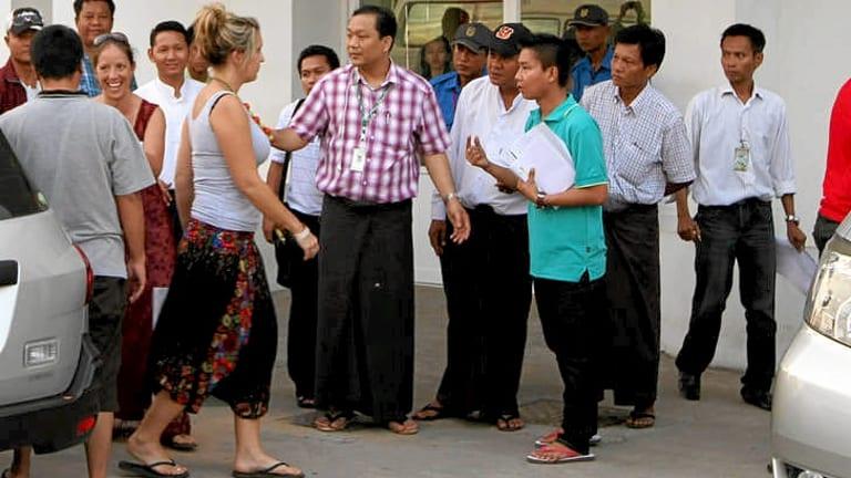 A woman identified as a crash survivor outside a Yangon hospital.