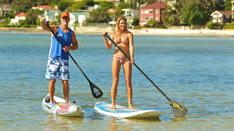Paddleboarders Tommy Woodriff and Sophie Morgan at Sydney's Rose Bay.