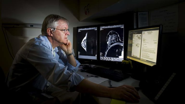 Dr Jeremy Price reviews the images of an MRI image showing a small cancer on the breast at Calvary Hospital.