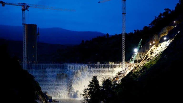 Dam full ... water flowed freely over the new Cotter Dam last night.