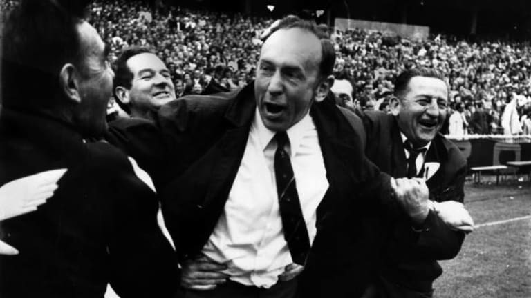Hawthorn coach John Kennedy being congratulated on his team's 1971 grand final win.