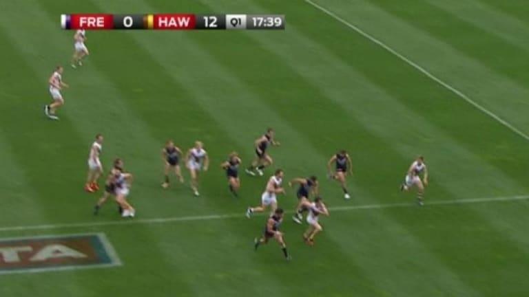 Fremantle's Nat Fyfe (left) swings his arm into Hawthorn's Jordan Lewis.