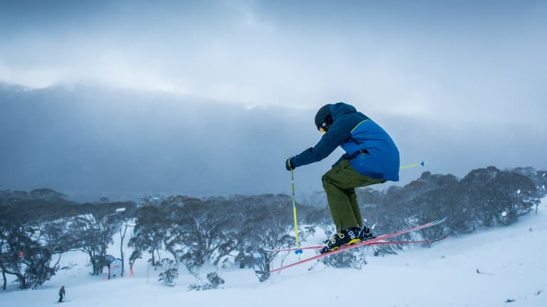 A skier at Thredbo gets some elevation on Saturday.