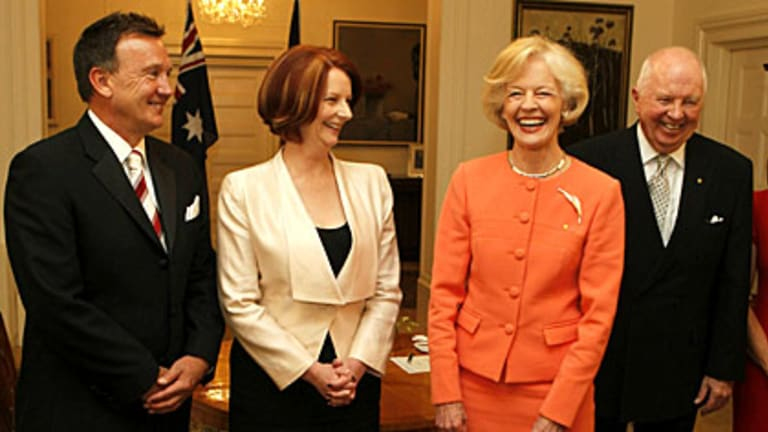 Julia Gillard is sworn in as Prime Minister by Governor-General Quentin Bryce. Also pictured is first man Tim Mathieson and Michael Bryce.