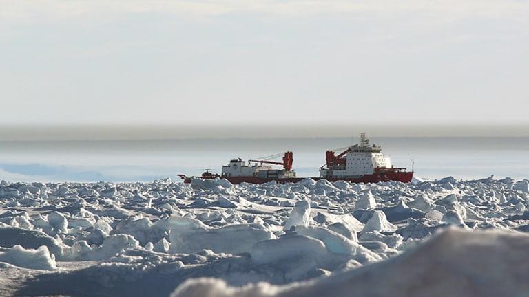 The Chinese icebreaker Xue Long remains stuck in sea ice in Watt Bay, Antarctica, near the beset vessel Akademik Shokalskiy.