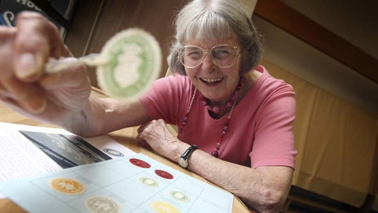 Daphne Martin is studious about her stamp collecting.