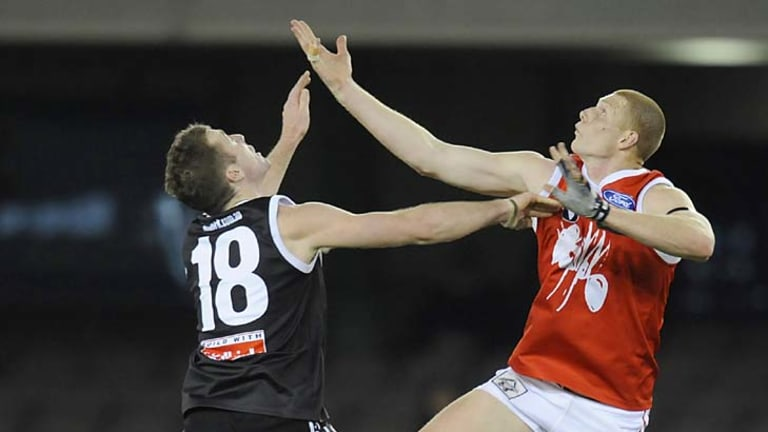 Up and away: Orren Stephenson (left) in action with North Ballarat.