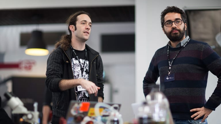 Meow Meow and Penzo wait to present their project BioHack Van at a competition in Melbourne on Saturday.