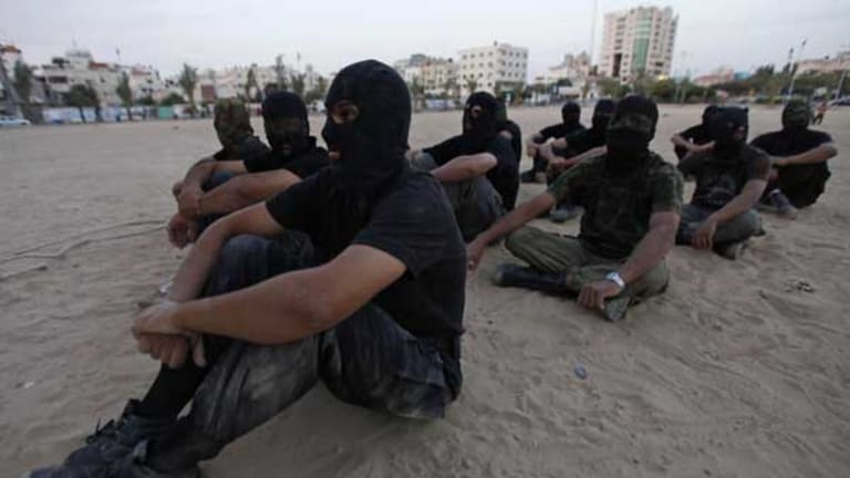 The 'Ezz Al-Din Al Qassam' militia, the military wing of Hamas, during a training session in Gaza City.