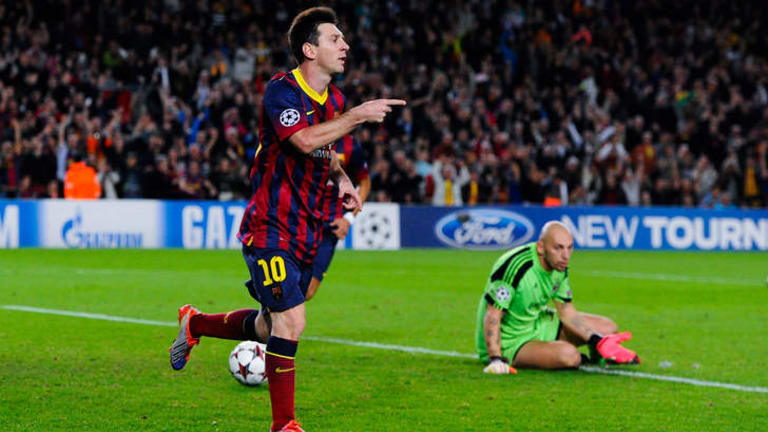 Champions League: Lionel Messi's double leads Barcelona to win over AC Milan