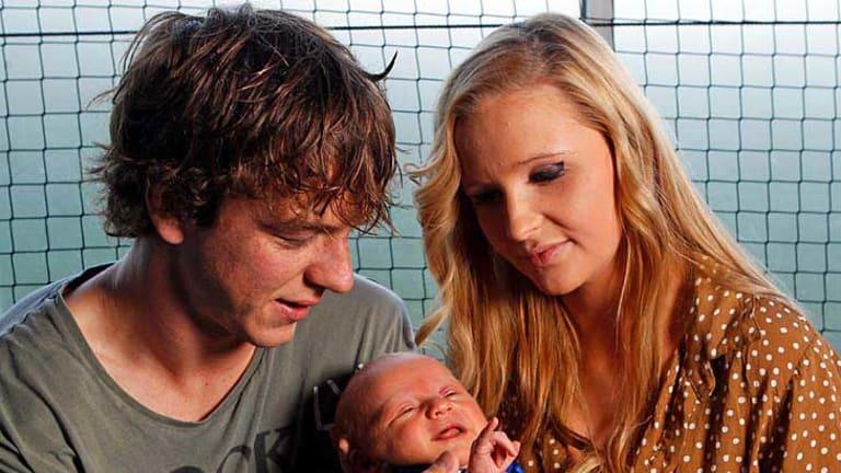 Western Bulldogs midfielder Liam Picken and partner Annie Nolan, with their four-week-old son, Malachy.