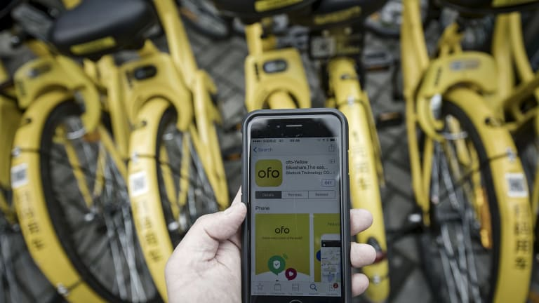 The Ofo bike sharing app is seen on a smartphone.