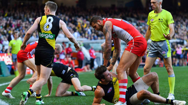 Lance Franklin wrestles with Alex Rance after his bump on Connor Menadue sparked a melee.