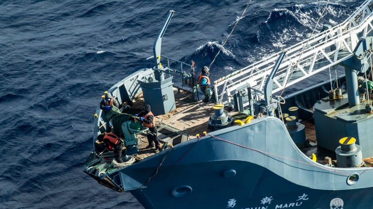 Crew on Japanese hunting ship Yusin Maru cover the harpoon on Sunday after Sea Shepherd activists track the fleet.