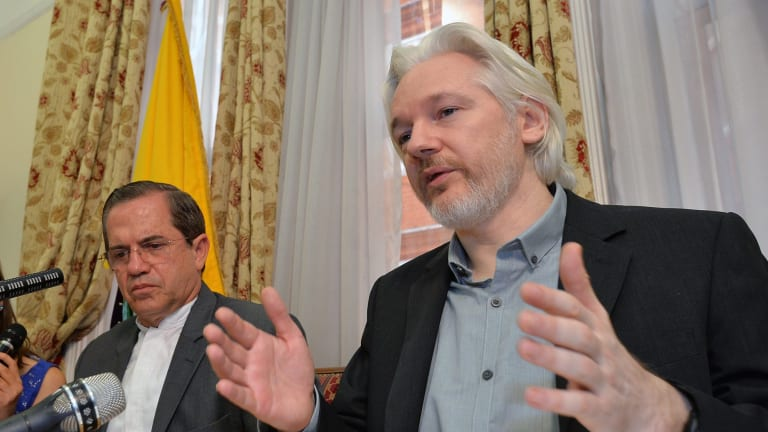 Julian Assange (right) and Ecuadorian Foreign Minister Ricardo Patino address media at the Ecuadorian embassy in 2014.