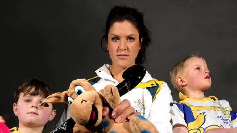 Olympics with Hockeyroo Anna Flanagan , with Universities Bunyips juniors Elizabeth Harlum (8) and Patrick Compton (5).