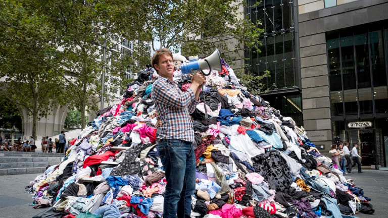 The Chaser's Craig Reucassel dumps six tonnes of 'fashion waste' in Sydney's Martin Place - to show the volume of clothes going to landfill in Australia every 10 minutes.